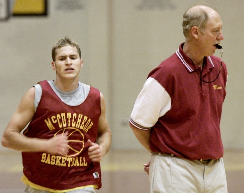 Kevin Downham runs wind sprints at the end of a practice as coach Rick Peckinpaugh keeps an eye on other players.
