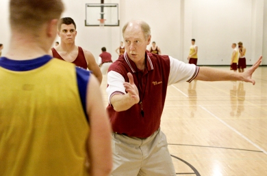 Rick Peckinpaugh goes over a defensive play with Dave Crandall and Clayton Richard (back) during a practice. Peckinpaugh does not do a lot of teaching during practice. He expects the players to know what to do by the time they make it to the varsity team.