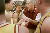 Coach Rick Peckinpaugh looks at the clock at the end of a time-out during a close game.